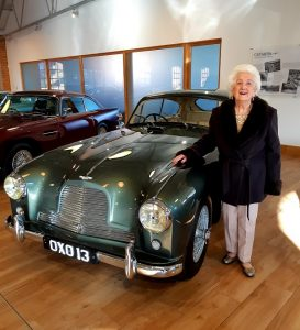 Beryl at Aston Martin showroom in Newport Pagnell